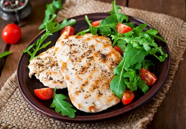 Chicken breast with fresh salad - arugula and tomato