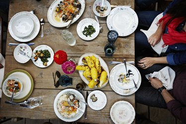 Overhead view of friends dining mid-meal