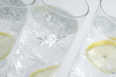 Glasses objects with soda water and ice cubes