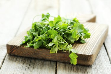 Parsley on grey wooden background