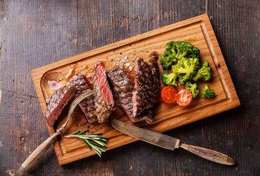 Sliced medium rare grilled steak Ribeye with broccoli