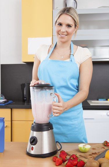 Woman Making Strawberry Milkshake
