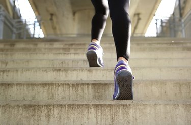 Sports female running up stairs