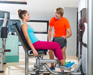 Hip abduction woman exercise at gym closing
