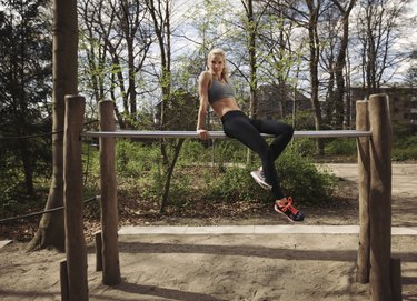 Fitness female taking rest after workout at park
