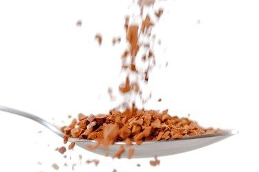 Chocolate powder falling in a spoon