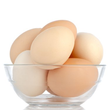 Brown eggs in transparent bowl