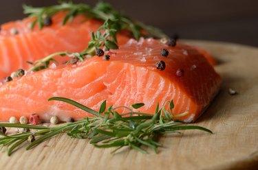 Raw salmon on cutting board