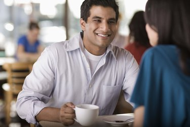 Couple having coffee in cafe
