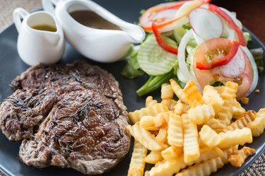 Rustic grilled beefsteak with french fries