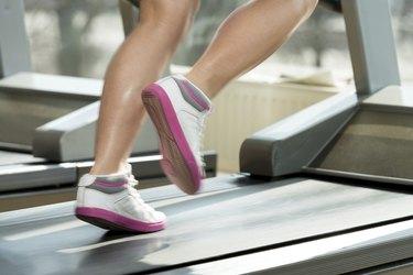 Fitness Woman Running On Treadmill