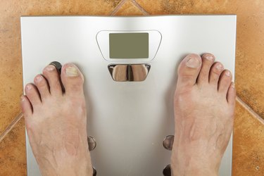 Man looks at a personal scale.