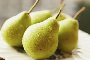Green pears on a white plate