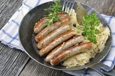 Fried sausages on sauerkraut