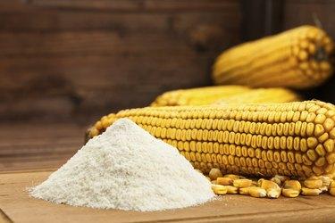 Domestic corn flour arranged with maize cob