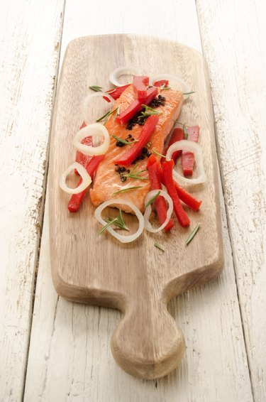 grilled salmon fillet on wooden board