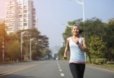 fit sports woman running at street