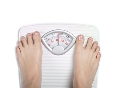 Diet bathroom scale on white