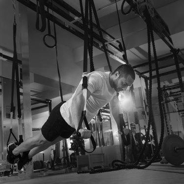 Crossfit fitness TRX push ups man workout