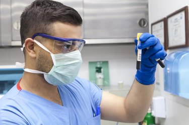 Doctor working on test tubes
