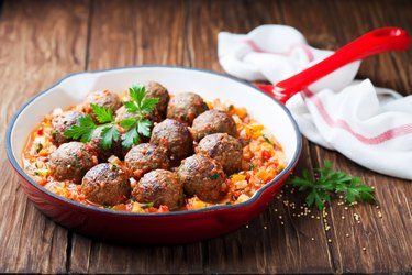 Meatballs with vegetable sauce in cast iron skillet