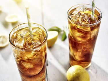 two ice cold glasses of iced tea with lemons