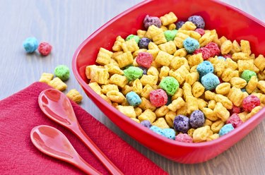 Bowl of cereal and spoons on wooden  table