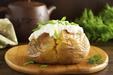 Baked potato with cream of the cream cheese closeup.