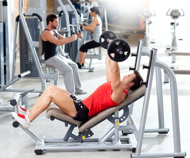 group with weight training equipment on sport gym