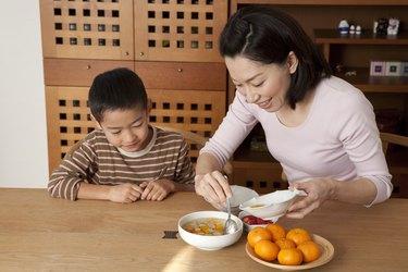 Mother Serving Dessert for Son