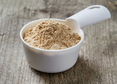 Measuring scoop of maca powder