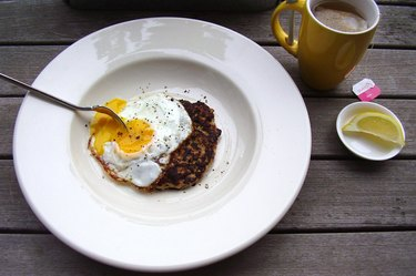 A sausage patty topped with an egg.