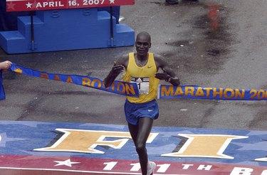 Man crossing the finish line at the Boston Marathon
