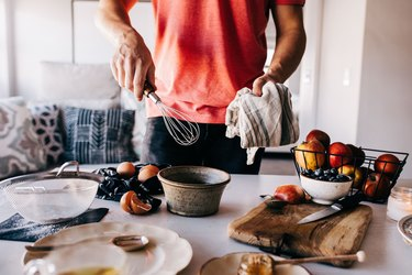 Man using kitchen tools for meal prep