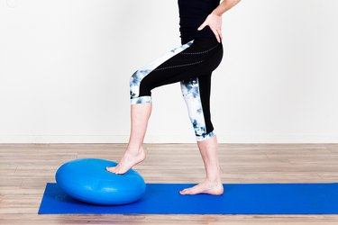 Woman Doing VMO Stability-Ball Press to Recover from an Injury