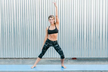 Woman performing arm reach exercise.