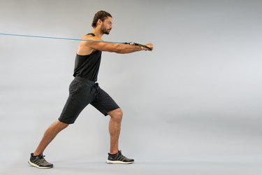 Man using a resistance band to do an upper body workout