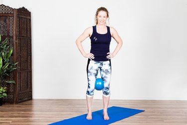 Woman Doing Standing VMO Contractions to Recover from an Injury