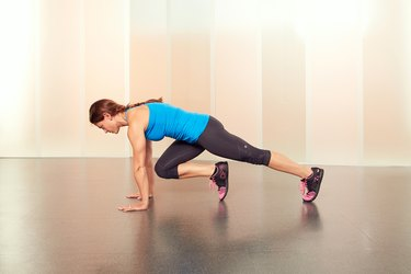 Woman Demonstrating Cross-Body Mountain Climbers in Her Hotel Room