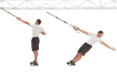 Man performing TRX Power Pull on the TRX Suspension Trainer