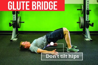 Man doing glute bridge with proper form to prevent back pain