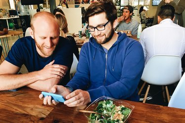 two men eating lunch