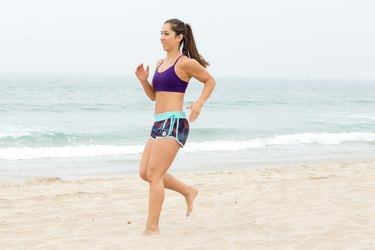 Woman Backpedalling During Her Beach Workout