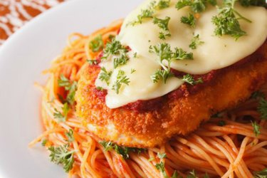 Chicken Parmigiana and pasta close-up on a plate