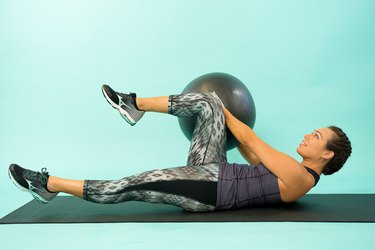 Woman exercising with Swiss ball.