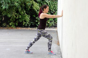 Woman Doing Calf Stretch to Strengthen Knees