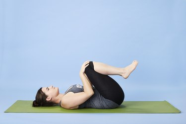 Woman performing one-minute stretch for back pain