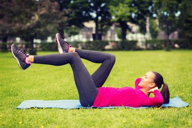 Bicycle crunches add variety to your ab routine.