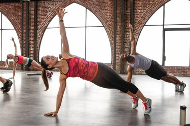 people doing a side plank during a STRONGER workout