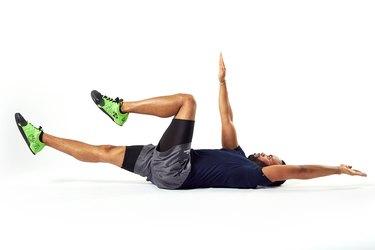 man doing a dead bug abdominal exercise